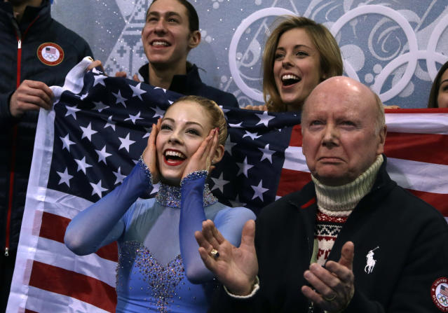 Gracie Gold of the United States, left, reacts in the results area after competing in the women's team free skate figure skating competition at the Iceberg Skating Palace during the 2014 Winter Olympics, Sunday, Feb. 9, 2014, in Sochi, Russia. (AP Photo/Darron Cummings, Pool)