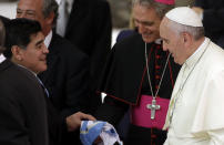 FILE - In this Monday, Sept. 1, 2014 file photo, Diego Armando Maradona, left, greets Pope Francis in the Paul VI hall at the Vatican, ahead of an inter-religious match for peace. Diego Maradona has died. The Argentine soccer great was among the best players ever and who led his country to the 1986 World Cup title before later struggling with cocaine use and obesity. He was 60. (AP Photo/Gregorio Borgia, File)