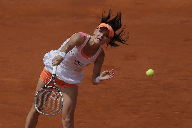 Agnieszka Radwanska from Poland serves during a Madrid Open tennis tournament semifinal match against Maria Sharapova from Russia in Madrid, Spain, Saturday, May 10, 2014. (AP Photo/Andres Kudacki)