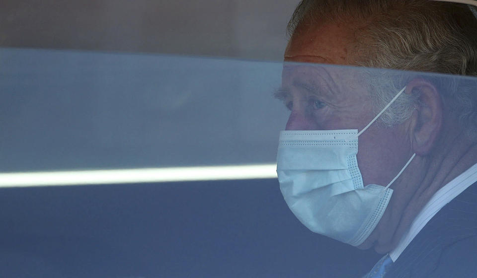 Britain's Price Charles leaves after visiting a NHS vaccine pop-up clinic at Jesus House church, in London, Tuesday March 9, 2021. (Yui Mok/PA via AP)