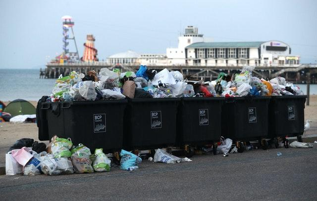 Waste ready to be collected after a busy day at Bournemouth beach