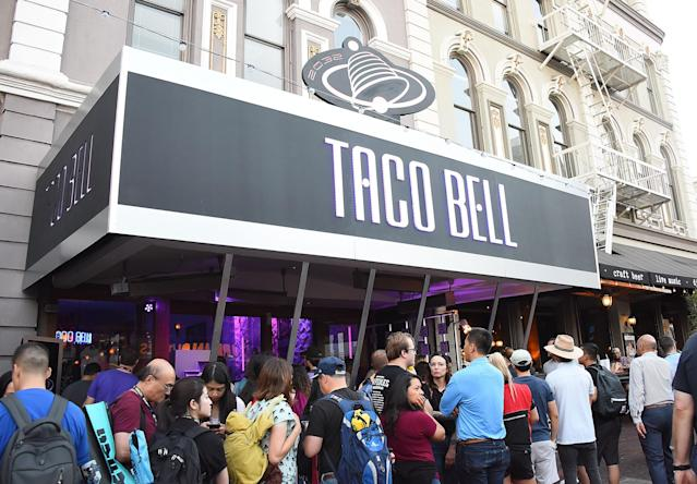People line up in front of a Taco Bell event celebrating <em>Demolition Man</em>'s25th anniversary, in San Diego during Comic-Con 2018. (Photo: Araya Diaz/Getty Images for Taco Bell)