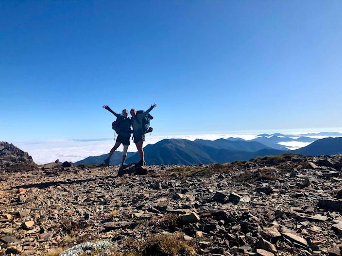 Claire Lewinski, right, and Ashley Ludack pose for a photo on the ridges of New Zealand's Richmond Ranges while thru-hiking the Te Araroa trail.