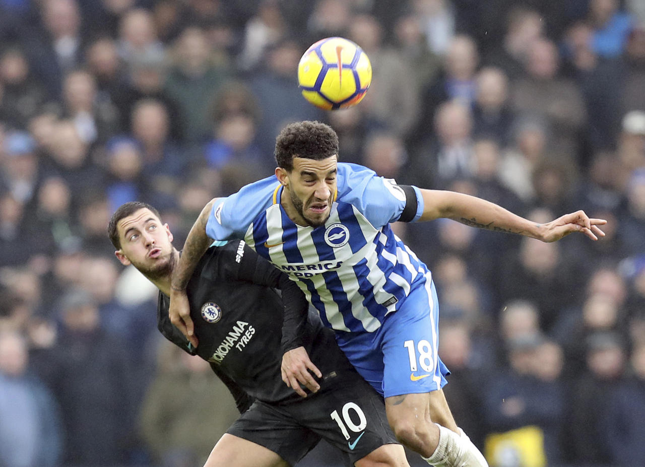 Chelsea's Eden Hazard, left, and Brighton & Hove Albion's Connor Goldson in action during their English Premier League soccer match at the AMEX Stadium in Brighton, England, Saturday Jan. 20, 2018. (Gareth Fuller/PA via AP)