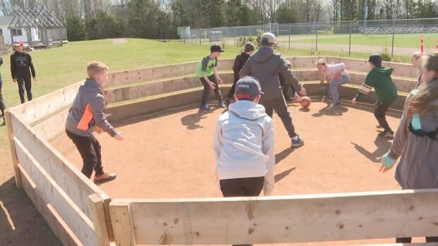 Eliot River students enjoy a game of gaga ball Wednesday afternoon. (Danny Arsenault/CBC - image credit)