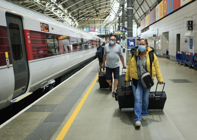 People wear a face masks at Leeds station, as train services increase as part of the easing of coronavirus lockdown restrictions. (Photo by Danny Lawson/PA Images via Getty Images)
