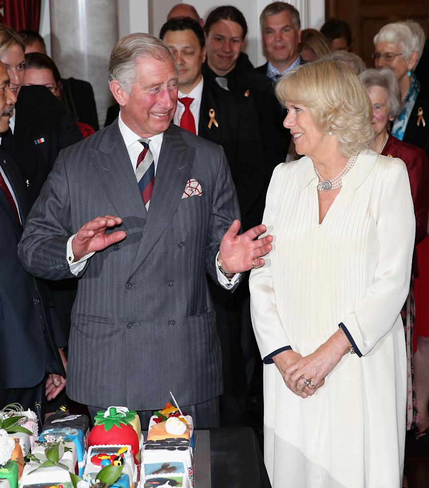 WELLINGTON, NEW ZEALAND - NOVEMBER 14:  Prince Charles, Prince of Wales dances as he is presented with his 64th birthday cake at Government House on November 14, 2012 in Wellington, New Zealand. The Royal couple are in New Zealand on the last leg of a Diamond Jubilee that takes in Papua New Guinea, Australia and New Zealand.  (Photo by Chris Jackson/Getty Images)