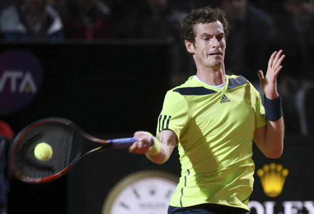 Britain's Andy Murray strikes a forehand to Spain's Rafael Nadal during their match at the Italian open tennis tournament in Rome, Friday, May 16, 2014. (AP Photo/Gregorio Borgia)