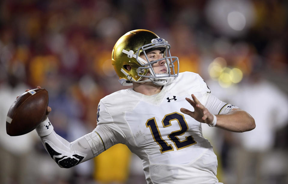 Brian Kelly's decision to sub in Ian Book (above) at quarterback has paid plenty of dividends for the Irish this season. (AP)