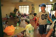 Residents rest inside a classroom used as a temporary shelter in Legaspi City, Albay province, south of Manila