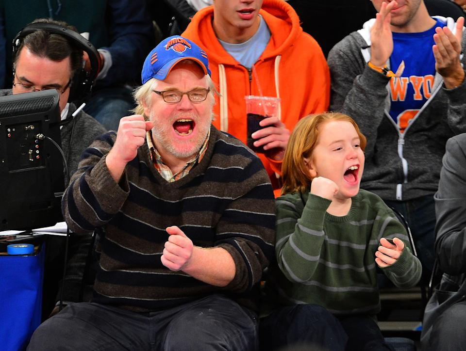 Philip Seymour Hoffman and Cooper Alexander Hoffman attend a basketball game on January 1, 2013. (Photo by James Devaney/FilmMagic)