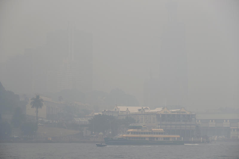 A ferry sails on the harbor as thick smoke settles in Sydney, Australia, Tuesday, Dec. 10, 2019. Hot dry conditions have brought an early start to the fire season. (AP Photo/Rick Rycroft)