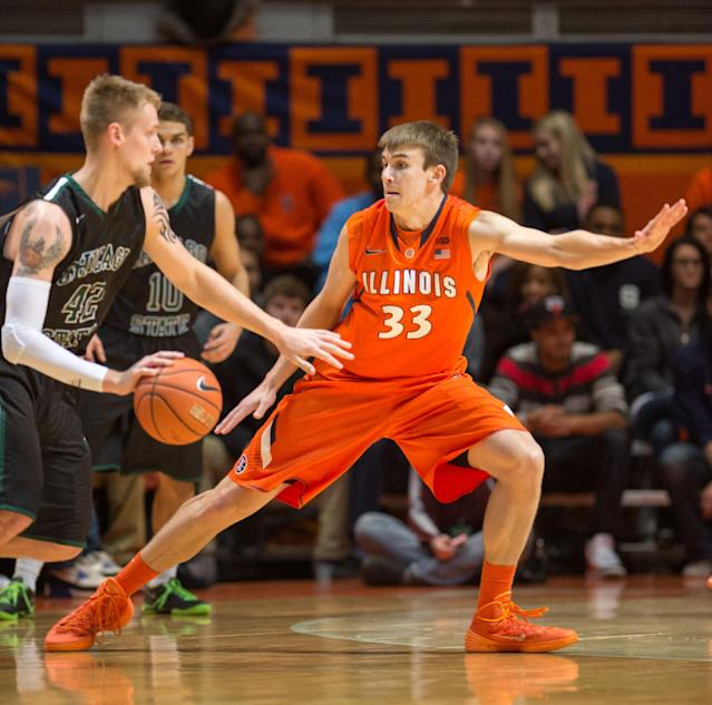 Illinois' Jon Ekey (33) tries to stay ahead of Chicago State's Matt Ross (42) during the first half of an NCAA college basketball game on Friday, Nov. 22, 2013, in Champaign, Ill. (AP Photo/Darrell Hoemann)