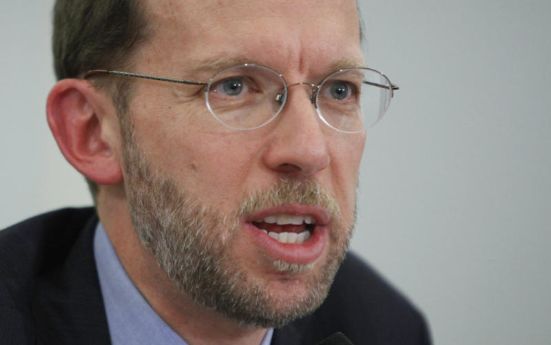 FILE - In this Jan. 27, 2010 file photo, Congressional Budget Office (CBO) Director Douglas Elmendorf testifies on Capitol Hill in Washington. Will President Barack Obama's health care law increase the government's huge deficit or reduce it? How many people will it really cover? How much will it cost taxpapers? Congress' nonpartisan budget scorekeepers release their findings, the first in-depth look at the law since the Supreme Court ruled it constitutional. (AP Photo/Manuel Balce Ceneta, File)