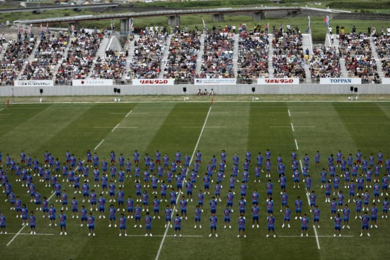 Students perform during the opening ceremony of the Kamaishi Recovery Memorial stadium