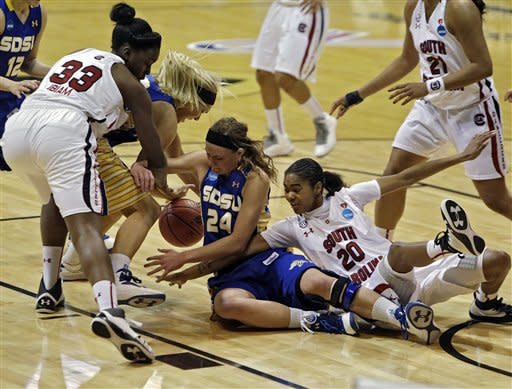 South Carolina forward Elem Ibiam (33) and guard Sancheon White (20) battle for a loose ball with South Dakota State center Katie Lingle (42) and forward Megan Waytashek (24) during the first half of a first-round women's NCAA basketball game on Saturday, March 23, 2013, in Boulder. (AP Photo/Ed Andrieski)