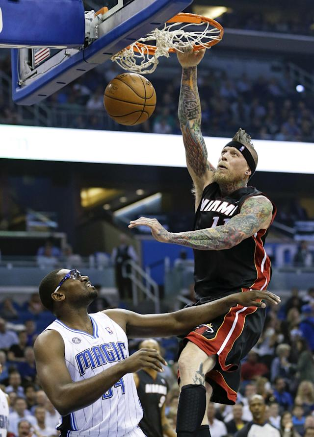Miami Heat's Chris Andersen, right, dunks the ball in front of Orlando Magic's Jason Maxiell, left, during the first half of an NBA basketball game in Orlando, Fla., Wednesday, Nov. 20, 2013. (AP Photo/John Raoux)