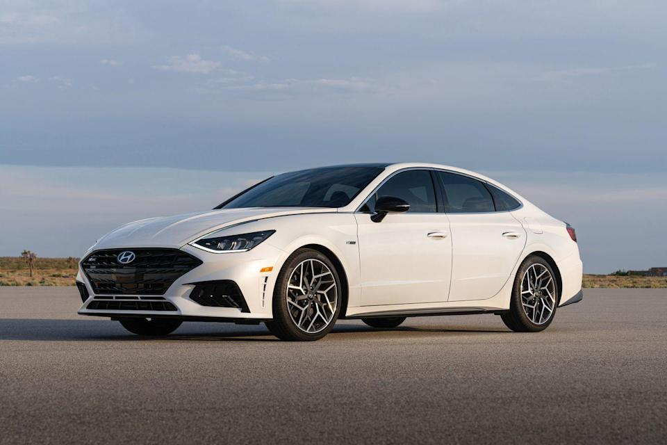 "<p>The <a href=""https://www.caranddriver.com/hyundai/sonata"" rel=""nofollow noopener"" target=""_blank"" data-ylk=""slk:2021 Hyundai Sonata"" class=""link rapid-noclick-resp"">2021 Hyundai Sonata</a> is a really good way to get attention while driving a family sedan. Its dramatic styling includes exaggerated proportions, a prominent grille, and a quirky design cue featuring a spear of bright trim that flows along the front fenders and into the headlights to create what designers call a ""lighting signature."" Inside, the Sonata flaunts a sophisticated, attractive space loaded with upscale features and plenty of passenger room. While the Sonata isn't quick or engaging to drive, it has a trio of efficient powertrains, including a hybrid option that has higher government fuel-economy ratings than the <a href=""https://www.caranddriver.com/toyota/camry"" rel=""nofollow noopener"" target=""_blank"" data-ylk=""slk:Toyota Camry hybrid"" class=""link rapid-noclick-resp"">Toyota Camry hybrid</a>. Still, the <a href=""https://www.caranddriver.com/hyundai"" rel=""nofollow noopener"" target=""_blank"" data-ylk=""slk:Hyundai"" class=""link rapid-noclick-resp"">Hyundai</a> is less about numbers and more about value, thanks to its affordable pricing and an impressive amount of content.</p><p><a class=""link rapid-noclick-resp"" href=""https://www.caranddriver.com/hyundai/sonata"" rel=""nofollow noopener"" target=""_blank"" data-ylk=""slk:Review, Pricing, and Specs"">Review, Pricing, and Specs</a></p>"