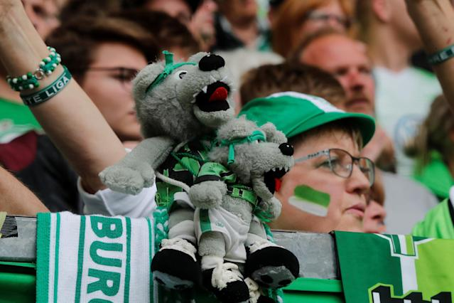 Soccer Football - Bundesliga - VfL Wolfsburg v FC Cologne - Volkswagen Arena, Wolfsburg, Germany - May 12, 2018 General view of Wolfsburg fans with toys REUTERS/Wolfgang Rattay DFL RULES TO LIMIT THE ONLINE USAGE DURING MATCH TIME TO 15 PICTURES PER GAME. IMAGE SEQUENCES TO SIMULATE VIDEO IS NOT ALLOWED AT ANY TIME. FOR FURTHER QUERIES PLEASE CONTACT DFL DIRECTLY AT + 49 69 650050