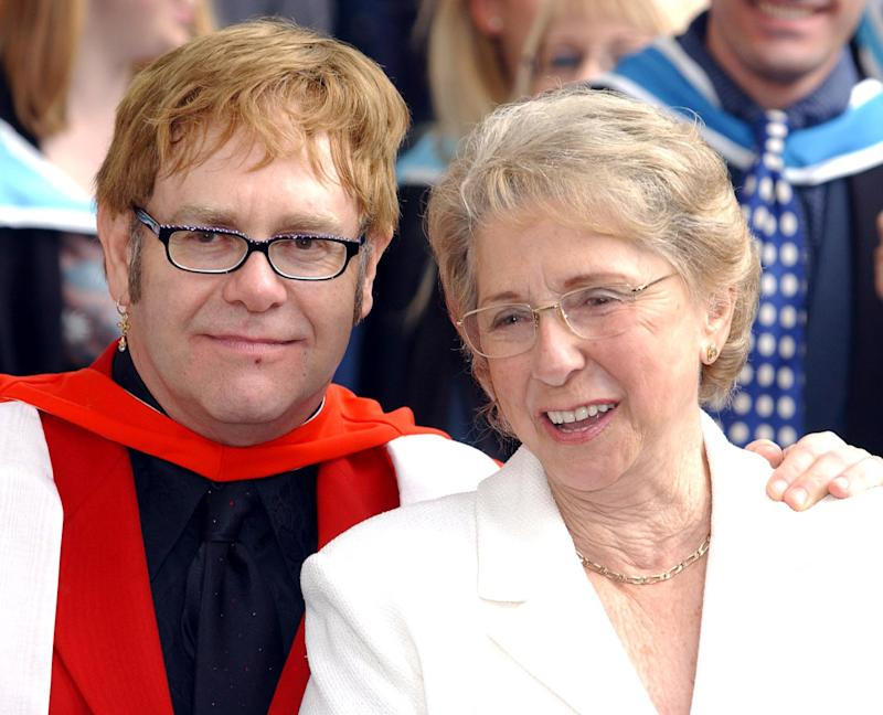 Sir Elton John with his mother, smiles after receiving an Honorary Doctorate from the Royal Academy of Music outside the Royal Academy of Music in London. * Sir Elton who studied at the Academy was accompanied by his partner David Furnish and his parents mother Sheila and stepfather Fred Fairbrother. (Photo by Andy Butterton - PA Images/PA Images via Getty Images)