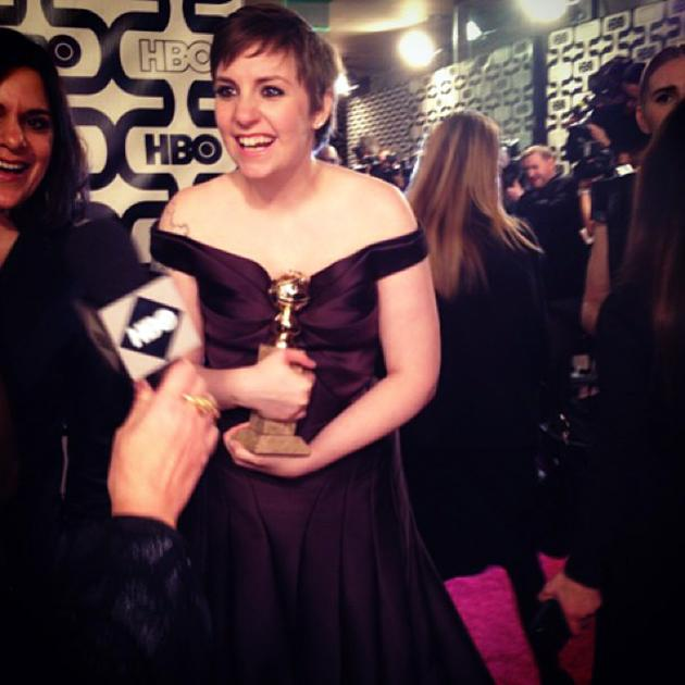 A beaming @lenadunham arrives on the #HBO #goldenglobes afterparty pink carpet. #girls @girlshbo - instagram/hbo