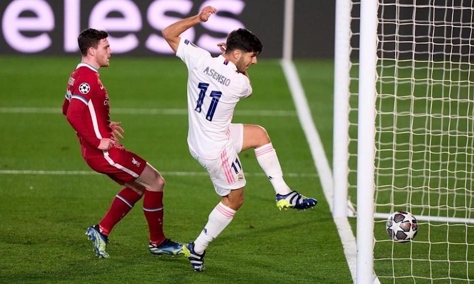 Marco Asensio of Real Madrid scores the second goal against Liverpool after flicking the ball over the Reds goalkeeper Alisson.