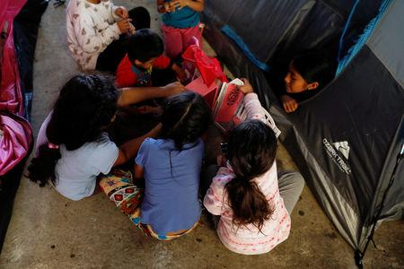 Children play outside a tent inside the shelter in Tijuana, Mexico April 6, 2019. Picture taken April 6, 2019. REUTERS/Carlos Jasso/Files