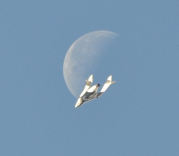 SpaceShipTwo shoots the moon during April 3 test flight at Mojave Air and Space Port.