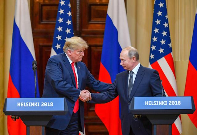 <p>U.S. President Donald Trump and Russia's President Vladimir Putin shake hands before attending a joint press conference after a meeting at the Presidential Palace in Helsinki, on July 16, 2018. (Photo: Yuri Kadobnov/AFP/Getty Images) </p>