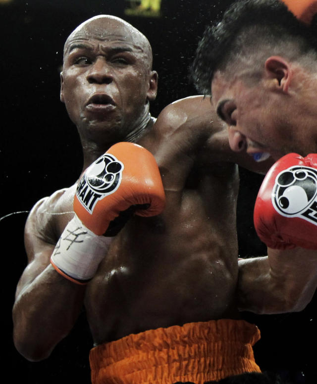 <p> FILE - This Sept. 17, 2011 file photo shows Floyd Mayweather Jr., left, punching Victor Ortiz during their WBC welterweight title fight in Las Vegas. Lawyers for Mayweather say the undefeated champion boxer may never fight again if he's not released from the Las Vegas jail he entered earlier this month. (AP Photo/Julie Jacobson, File) </p>