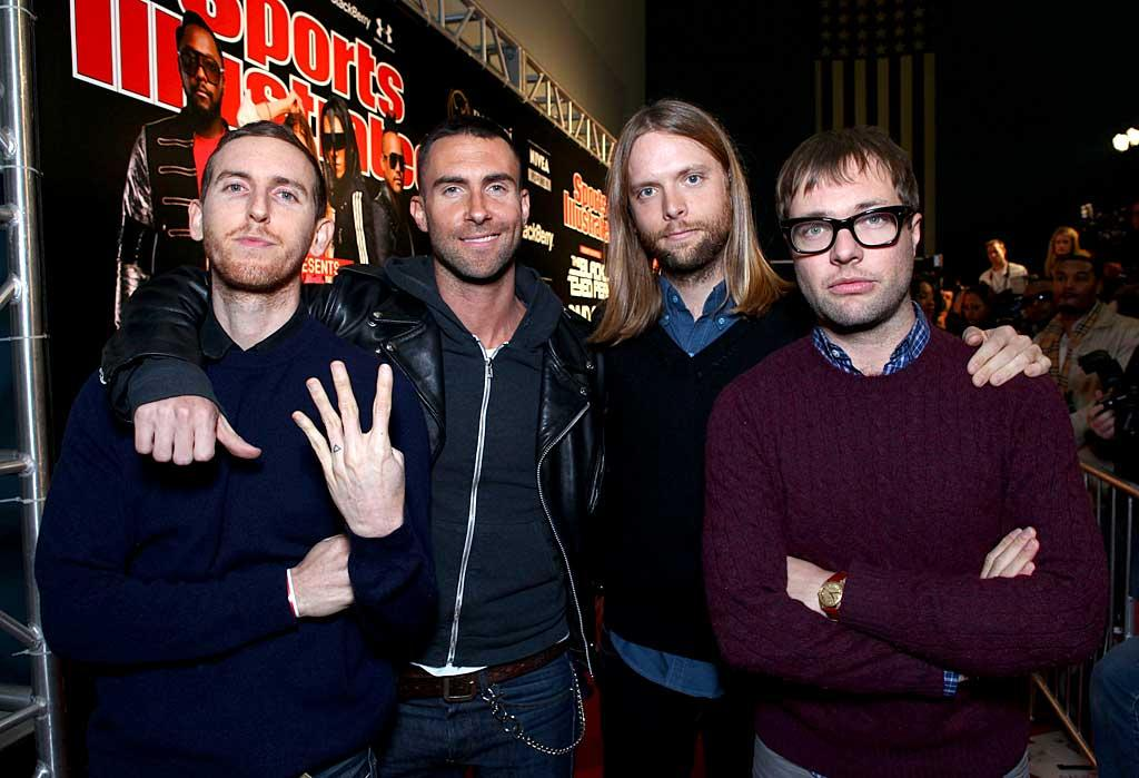 """Adam Levine and his Maroon 5 band mates partied at the Black Eyed Peas pre-Super Bowl soiree Friday night. Perhaps the singer needs to go back to school for a short stint? """"Not gonna lie. My knowledge of roman numerals is too limited to understand this years superbowl number,"""" Levine jokingly tweeted on Sunday. Tiffany Rose/<a href=""""http://www.gettyimages.com/"""" target=""""new"""">GettyImages.com</a> - February 4, 2011"""