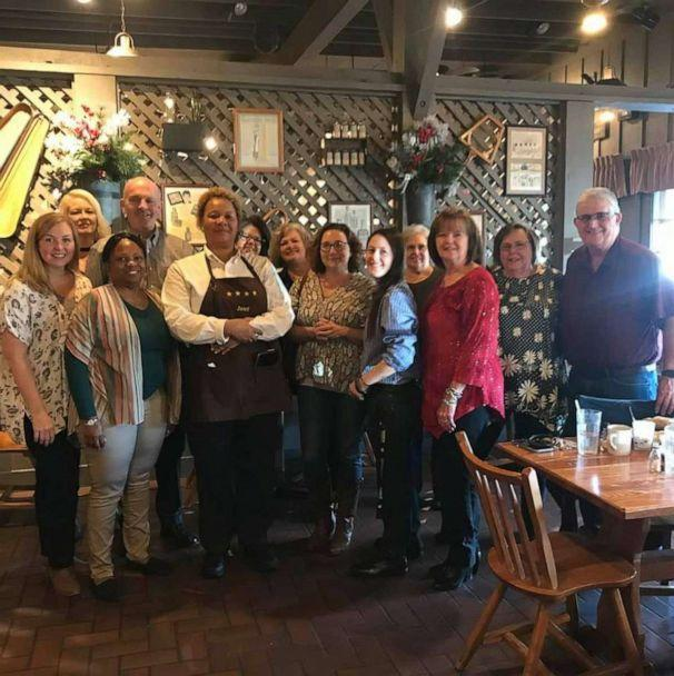 PHOTO: Janet Ballard with the group of 13 who gifted her a $1200 tip at a Cracker Barrel in Dublin, Georgia. (James Deal)