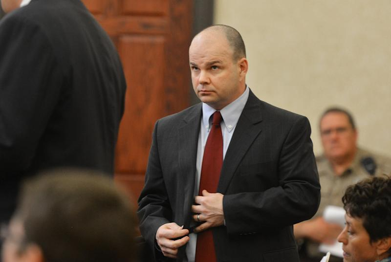 Sports agent Terry Watson, approaches the defendant's area before his first appearance hearing at the Orange County District Court on Wednesday Oct. 9, 2013, in Hillsborough, N.C. Watson is a Marietta-based professional accused of funneling thousands of dollars to former University of North Carolina player Greg Little. (AP Photo/The News & Observer, Churck Liddy)