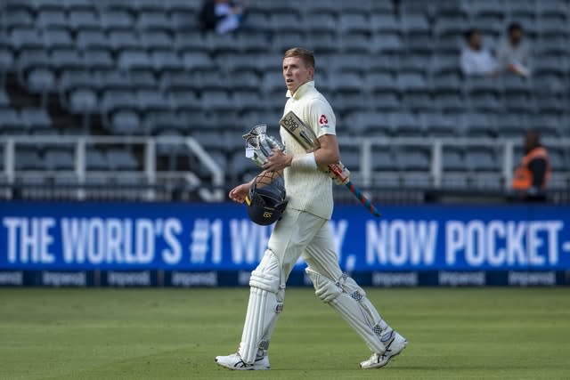England batsman Zak Crawley leaves the field after being dismissed by South Africa bowler Vernon Philander (Themba Hadebe/AP)