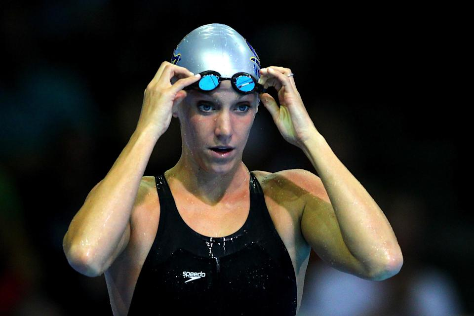 OMAHA, NE - JUNE 26: Dana Vollmer adjusts her goggles prior to competing in the championship final heat of the Women's 100 m Butterfly during Day Two of the 2012 U.S. Olympic Swimming Team Trials at CenturyLink Center on June 26, 2012 in Omaha, Nebraska. (Photo by Al Bello/Getty Images)