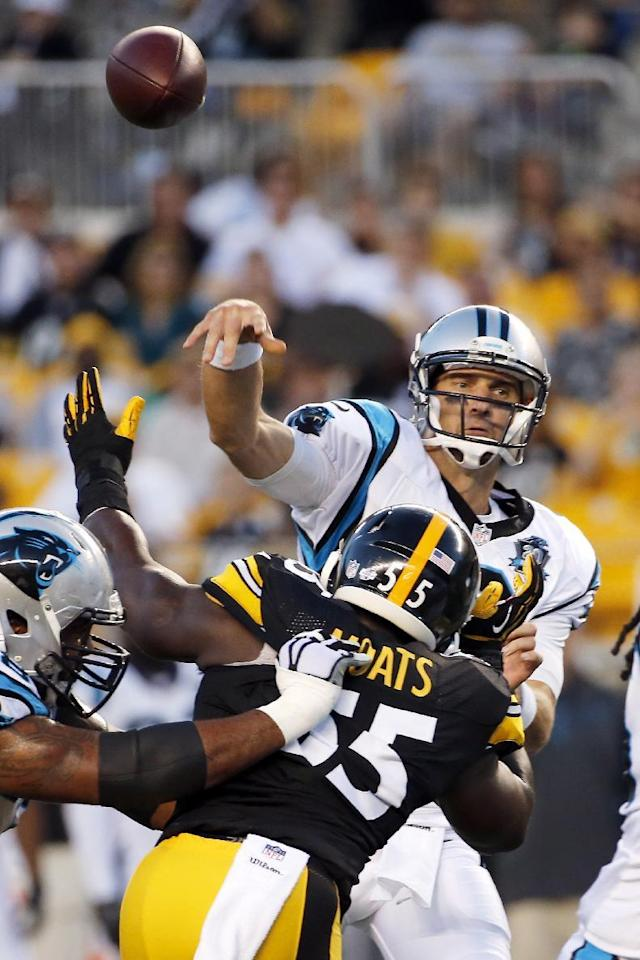 Carolina Panthers quarterback Derek Anderson (3) passes under pressure by Pittsburgh Steelers outside linebacker Arthur Moats (55) in the first quarter of the NFL preseason football game on Thursday, Aug. 28, 2014 in Pittsburgh. (AP Photo/Gene Puskar)
