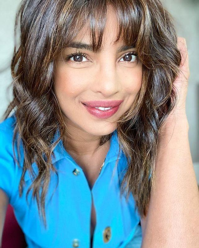 """<p>Priyanka Chopra entered into the lockdown hair transformation spirit of things with a brand new French girl fringe and tousled waves. The actress looked happy and glowing with her new laissez-faire 'do, captioning a selfie on Instagram: 'New hair, don't care.'</p><p><a href=""""https://www.instagram.com/p/CFBDMtJDr2x/?utm_source=ig_embed&utm_campaign=loading"""" rel=""""nofollow noopener"""" target=""""_blank"""" data-ylk=""""slk:See the original post on Instagram"""" class=""""link rapid-noclick-resp"""">See the original post on Instagram</a></p>"""