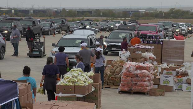 A food distribution line at the San Antonio Food Bank. During the pandemic, many have been relying on food banks for the first time to feed their families. / Credit: CBS News