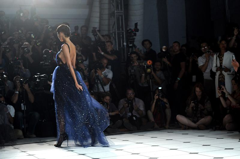 A model walks the runway at the Jason Wu spring 2013 show, Friday, Sept. 7, 2012 in New York. (Photo by Diane Bondareff/Invision/AP)