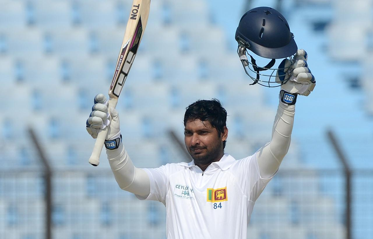 Sri Lankan batsman Kumar Sangakkara acknowledges the crowd after scoring a double century (200 runs) during the second day of the second Test match between Bangladesh and Sri Lanka at The Zahur Ahmed Chowdhury Stadium in Chittagong on February 5, 2014. AFP PHOTO/ Munir uz ZAMAN