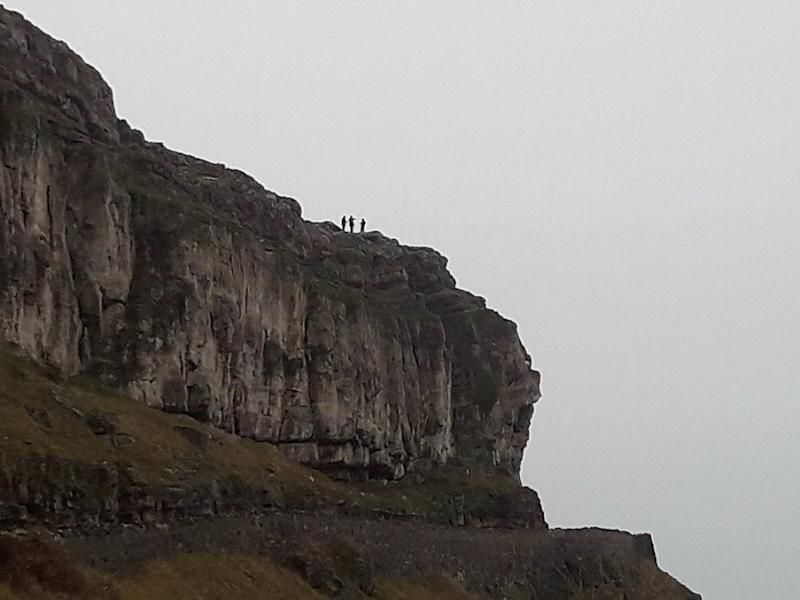 RSPCA officers had to abseil down the cliff and put the sheep in a bag before pulling it to safety (PA)