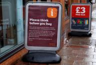 FILE PHOTO: General view of a sign warning customers of product shortages outside a Sainsbury's Local supermarket in Birmingham