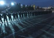 Police block the central square in Ulan-Ude, the regional capital of Buryatia, a region near the Russia-Mongolia border, Russia, Wednesday, April 21, 2021. Navalny's team has called for nationwide protests on Wednesday following reports that the politician's health was deteriorating in prison, where he has been on hunger strike since March 31. Russian authorities have stressed that the demonstrations were not authorized and warned against participating in them. (AP Photo/Anna Ogorodnik)