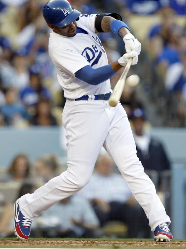 Los Angeles Dodgers' Matt Kemp hits a two-run home run against the San Francisco Giants in the fourth inning of a baseball game Sunday, April 6, 2014, in Los Angeles. It was Kemp's second home run of the game.(AP Photo/Alex Gallardo)