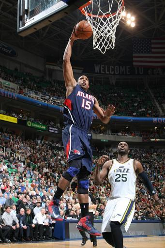 SALT LAKE CITY, UT - FEBRUARY 27: Al Horford #15 of the Atlantic Hawks goes up for the dunk past Al Jefferson #25 of the Utah Jazz at Energy Solutions Arena on February 27, 2013 in Salt Lake City, Utah. (Photo by Melissa Majchrzak/NBAE via Getty Images)
