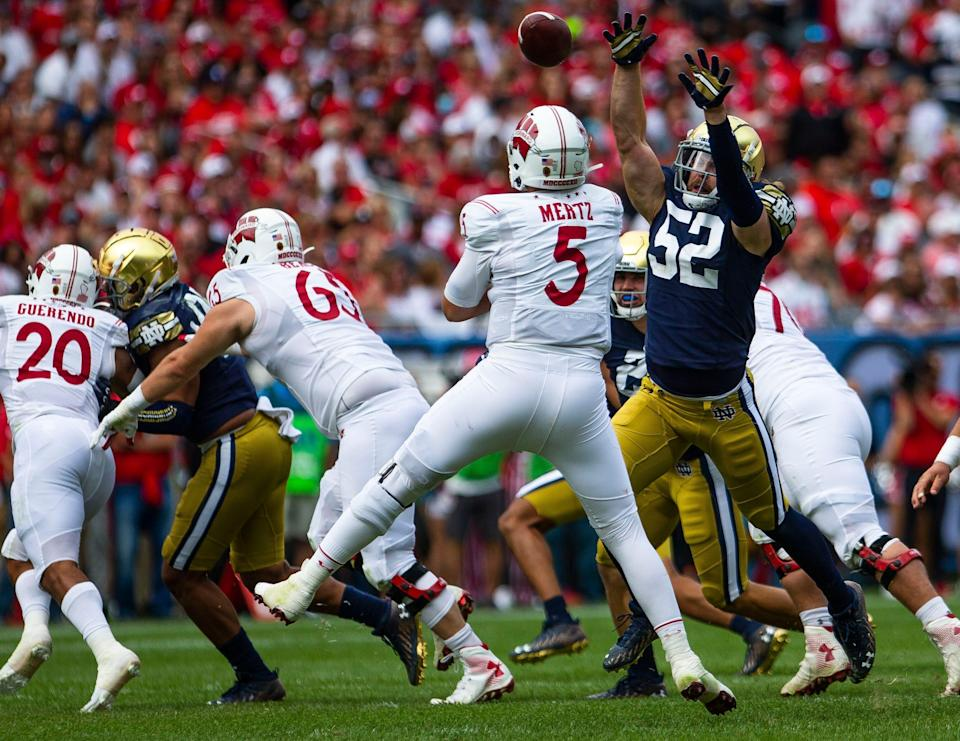 Notre Dame's Bo Bauer (52) defends Wisconsin's Graham Mertz (5) during the Notre Dame vs. Wisconsin NCAA football game Saturday, Sept. 25, 2021 at Soldier Field in Chicago.