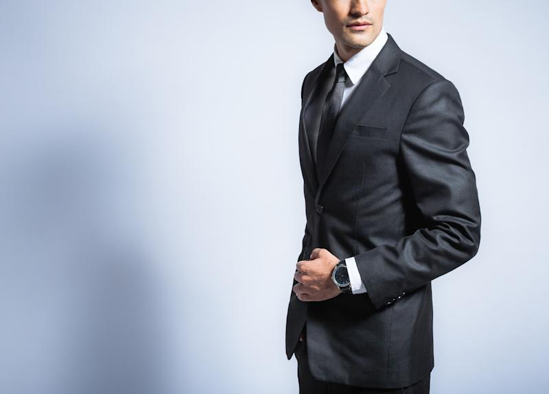 A man posing in a suit.
