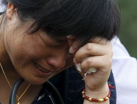 A relative of a passenger of the sunken cruise ship cries on a road to the site of the sinking in the Jianli section of Yangtze River, Hubei province, China, June 3, 2015. REUTERS/Kim Kyung-Hoon