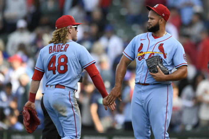 St. Louis Cardinals closing pitcher Luis Garcia right, celebrates with teammate Harrison Bader (48) after defeating the Chicago Cubs in a baseball game Saturday, Sept. 25, 2021, in Chicago. (AP Photo/Paul Beaty)