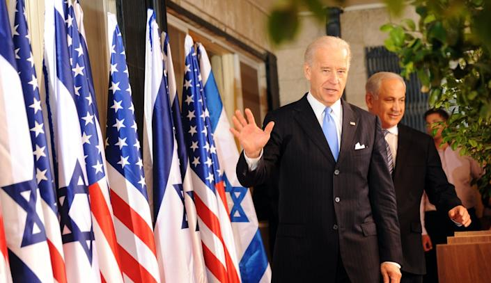 """<span class=""""caption"""">Biden believes in a two-state solution to the Israeli-Palestinian conflict but is a strong supporter of Israel.</span> <span class=""""attribution""""><a class=""""link rapid-noclick-resp"""" href=""""https://www.gettyimages.com/detail/news-photo/vice-president-joe-biden-waves-to-photographers-as-he-news-photo/97575629?adppopup=true"""" rel=""""nofollow noopener"""" target=""""_blank"""" data-ylk=""""slk:Photo by Debbi Hill - Pool/ Getty Images"""">Photo by Debbi Hill - Pool/ Getty Images</a></span>"""